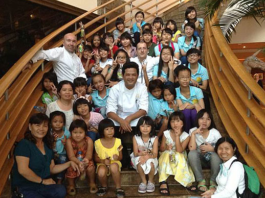 The kids on the stairs in the Sofitel Hanoi