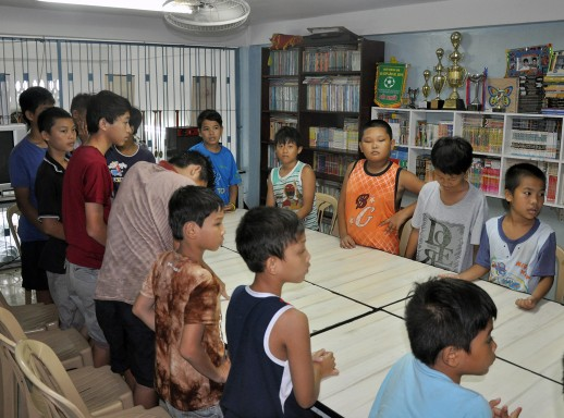 the boys from Sunlight House in their classroom